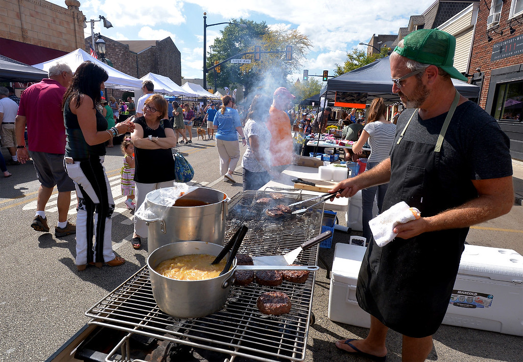 . Lucky Well owner Chad Rosenthal grills in front of his restaurant during the Ambler Oktoberfest Oct. 7, 2017. / Bob Raines--Digital First Media