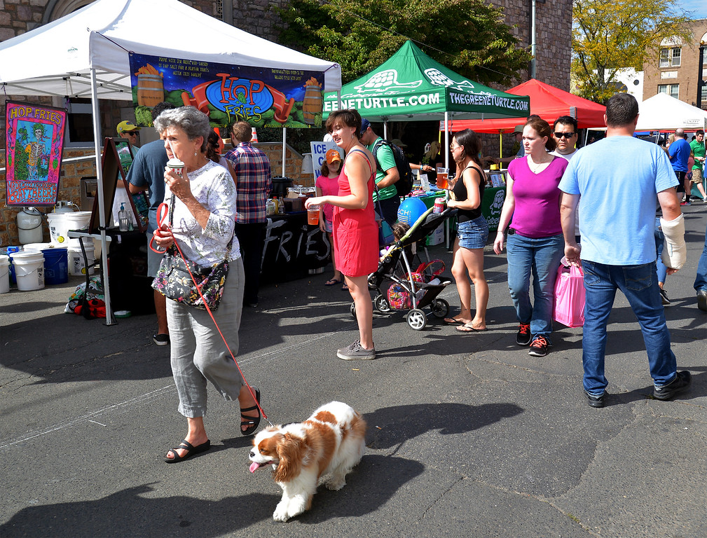 . People walk from booth to booth along Ridge Ave. to sample food and drink at the Ambler Oktoberfest Oct. 7, 2017. / Bob Raines--Digital First Media