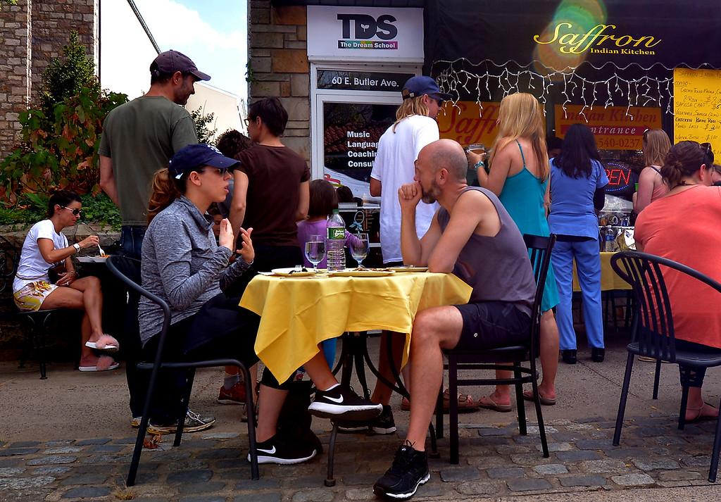 . Oktoberfest visitors take advantage of the many sidewalk tables along Butler Ave., Ambler Oct. 7, 2017. / Bob Raines--Digital First Media