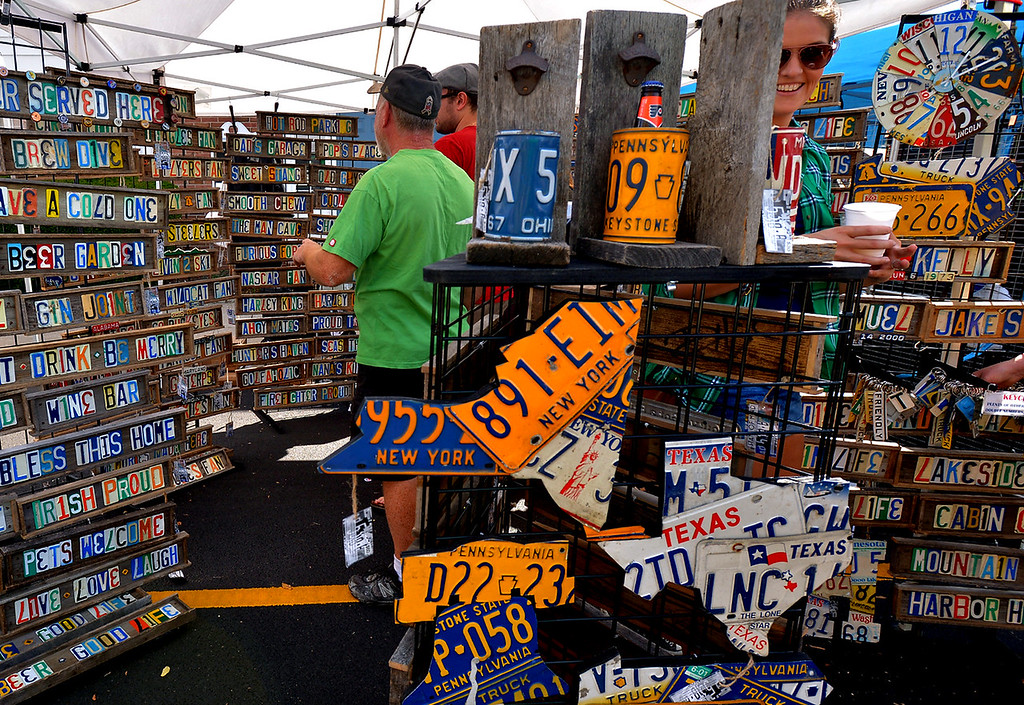 . The State of Mind booth attracts browsers with items made from old license plates at the Ambler Oktoberfest Oct. 7, 2017. / Bob Raines--Digital First Media