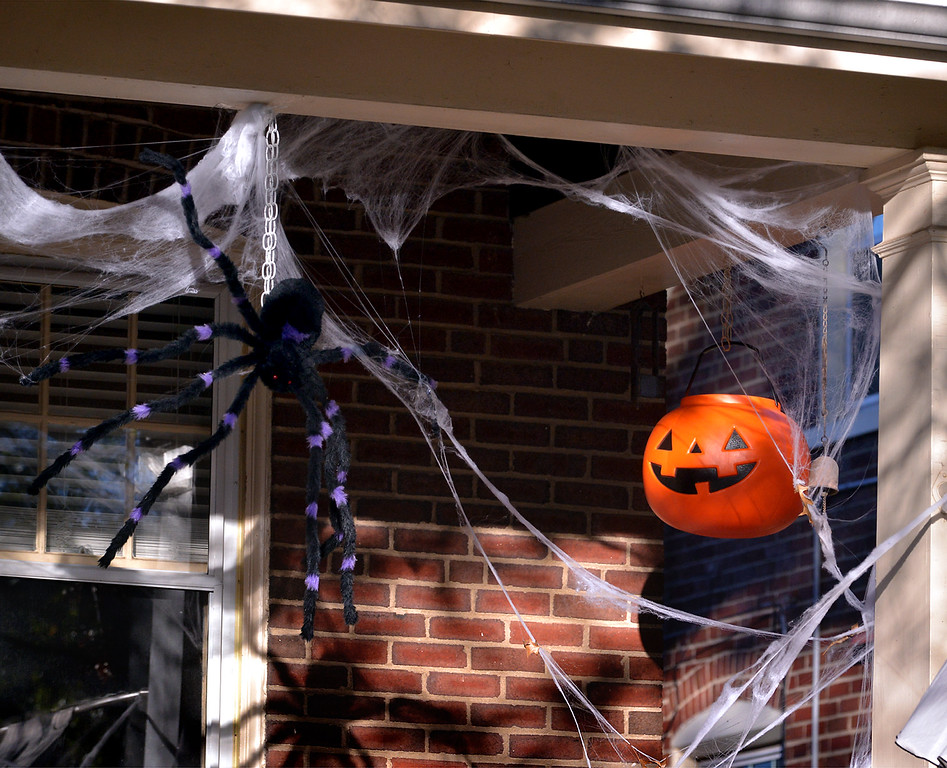 . A giant spider spins its web as a jack-o-lantern smiles on the front porch of a house in Lansdale Oct 27, 2017. (Bob Raines--Digital First Media)