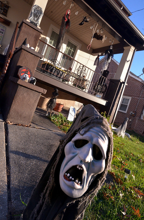 . A screaming ghoul meets visitors near the sidewalk in front of a house on Susquehanna Ave., Lansdale Oct 27, 2017. (Bob Raines--Digital First Media)
