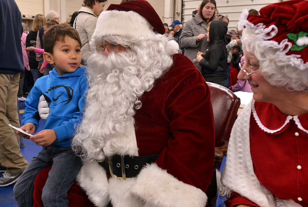 . Maika Heimbach, 5, tells Santa what he wants for Christmas at the Sellersville Fire Company Winterfest Dec. 5, 2017. (Bob Raines--Digital First Media)