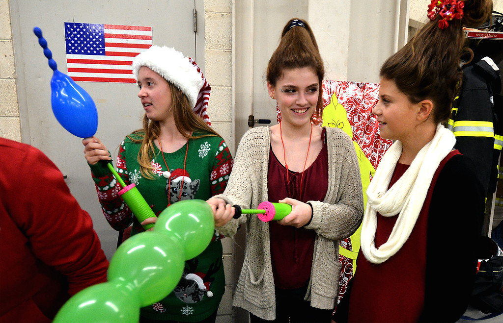 . Girls from Faith Church fill balloons at the Sellersville Fire Company Winterfest Dec. 5, 2017. (Bob Raines--Digital First Media)