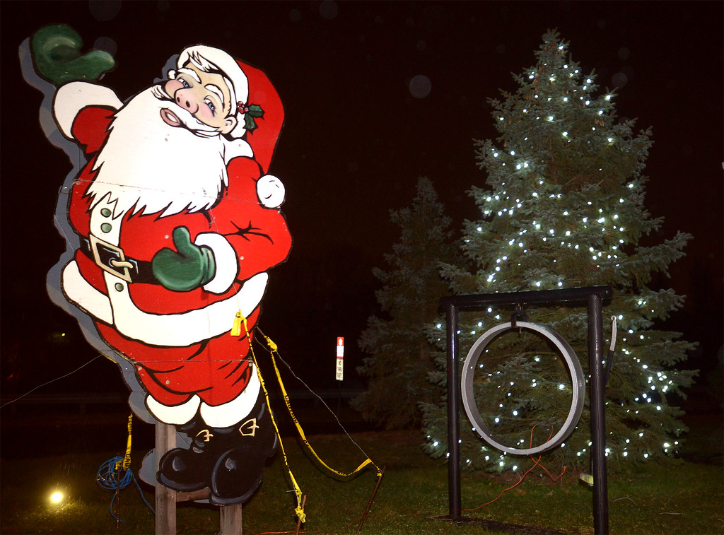 . A Santa cut-out stands in front of the Sellersville Fire Company Christmas tree during their annual Winterfest Dec. 5, 2017. (Bob Raines--Digital First Media)