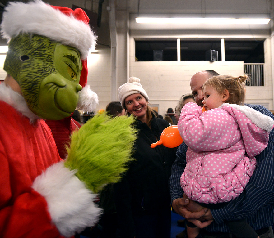 . Jeannie Werley and her parents, Sadie and Brent,  meet the Grinch at the Sellersville Fire Company Winterfest Dec. 5, 2017. (Bob Raines--Digital First Media)