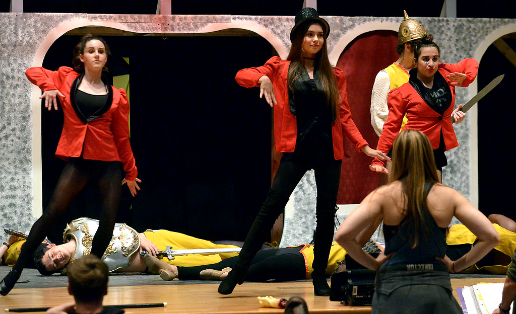 """. Leading Players Nicolette Smith, left, Juliet Kennedy, center, and Sarah Bruni dance as soldiers die in battle behind them in, \""""Glory,\"""" as YSTC prepares for, \""""Pippin,\"""" Dec. 11, 2017. (Bob Raines/Digital First Media)"""