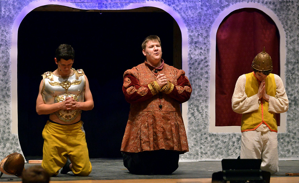 """. Lewis (Joey Nolan), left, and Pippin (Joe Correale) join their father, Charlemagne (Steven Rimdzius), in prayer to ask God\'s blessing in the coming fight against the Visigoths as YSTC rehearses, \""""Pippin,\"""" Dec. 11, 2017. (Bob Raines/Digital First Media)"""