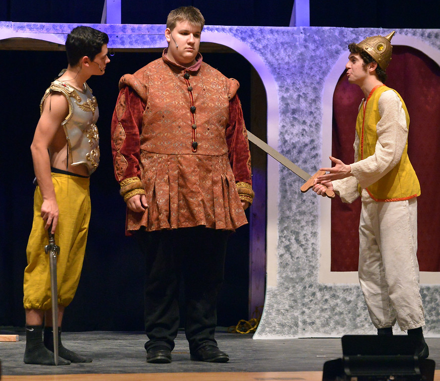 """. Pippin (Joe Correale), right, annoys his father, Charlemagne (Steven Rimdzius), center, and his brother, Lewis (Joey Nolan), with his enthusiasm as YSTC rehearses, \""""Pippin,\"""" Dec. 11, 2017. (Bob Raines/Digital First Media)"""