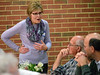 A volunteer chats with people who have come for the Zion Mennonite Church Table of Plenty Thanksgiving dinner Nov. 24, 2016.   |   Bob Raines--Digital First Media
