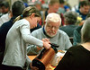 A young volunteer tops up coffee cups for diners at the Zion Mennonite Church Table of Plenty Thanksgiving dinner Nov. 24, 2016.   |   Bob Raines--Digital First Media