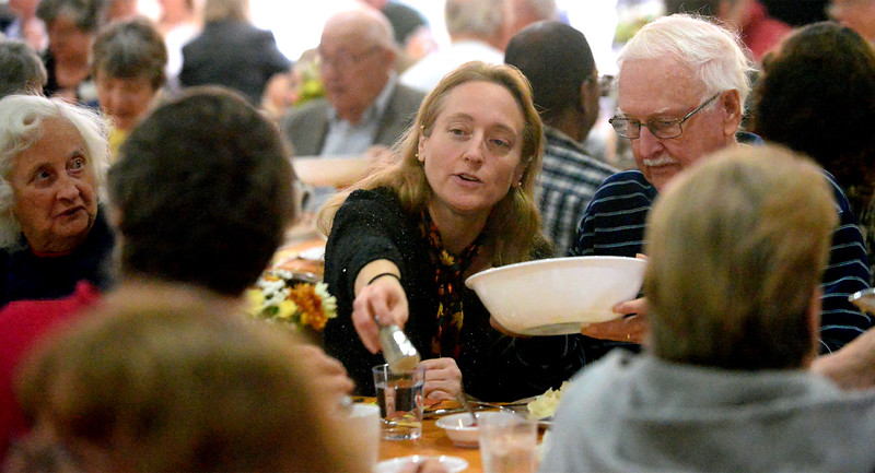 Both food and fellowship make their way along the tables at the Zion Mennonite Church Table of Plenty Thanksgiving dinner Nov. 24, 2016.   |   Bob Raines--Digital First Media