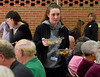 A young volunteer clears away serving bowls at the Zion Mennonite Church Table of Plenty Thanksgiving dinner Nov. 24, 2016.   |   Bob Raines--Digital First Media