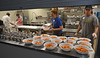 Volunteers set out gravy and sweet potatoes for servers to take to the tables at the Zion Mennonite Church Table of Plenty Nov. 24, 2016.   |   Bob Raines--Digital First Media