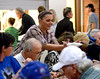 A server brings another bowl of food to be passed along the table at the Thanksgiving dinner served  family-style at the Zion Mennonite Church Table of Plenty Nov. 24, 2016.   |   Bob Raines--Digital First Media