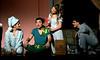 Peter Pan (Sam Caplan) describes Neverland to Michael (Bailey Rifkin), left, and John (Ben Helzner) while Wendy (Sadie Gustafson ) reattaches Peter's shadow.  (Bob Raines--Digital First Media)