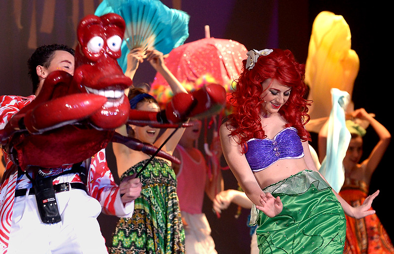 """Bob Raines--Digital First Media // <br /> Ariel (Amanda Warkow) enjoys the """"Under the Sea"""" party with Sebastian (Steven Aronow) for a little while before she sneaks off to seek help from Ursula in, """"The Little Mermaid,"""" showing April 7-9, 2016 at the Upper Dublin Performing Arts Center."""