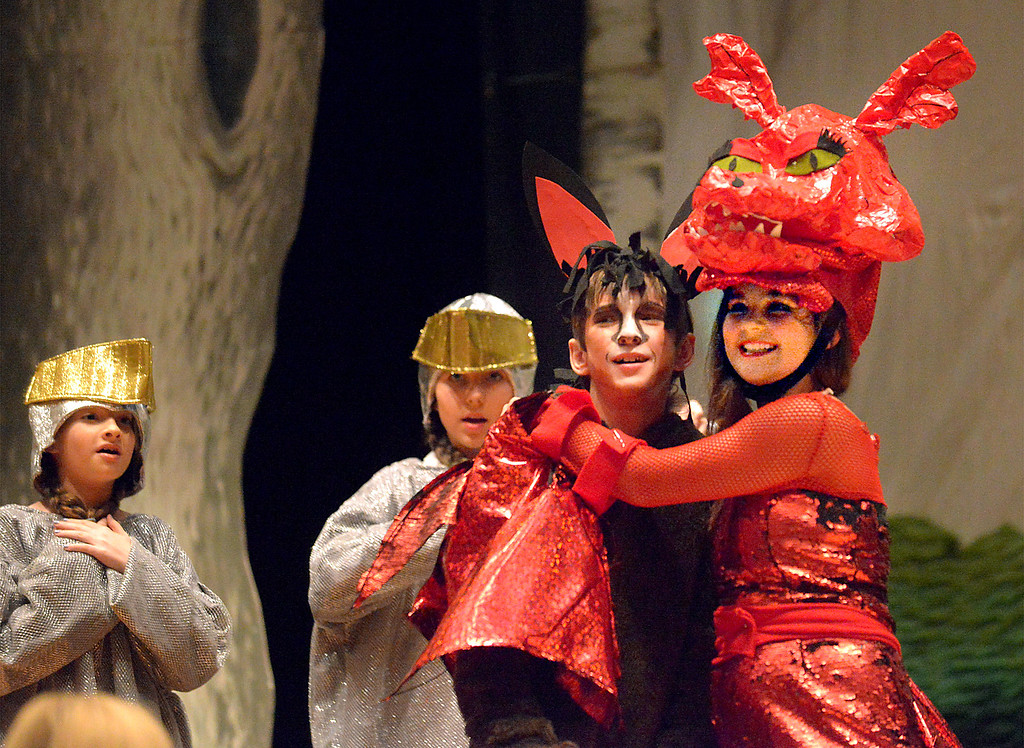". Bob Raines-- Digital First Media //  Dragon (Via Dell\'Angelo), infatuated with Donkey (Payton Breinich), gives him a hug rather than frying him as he expected during the Apr. 11, 2016 rehearsal for the Young Starrs Theater Company production of ""Shrek, The Musical, Jr.\"""