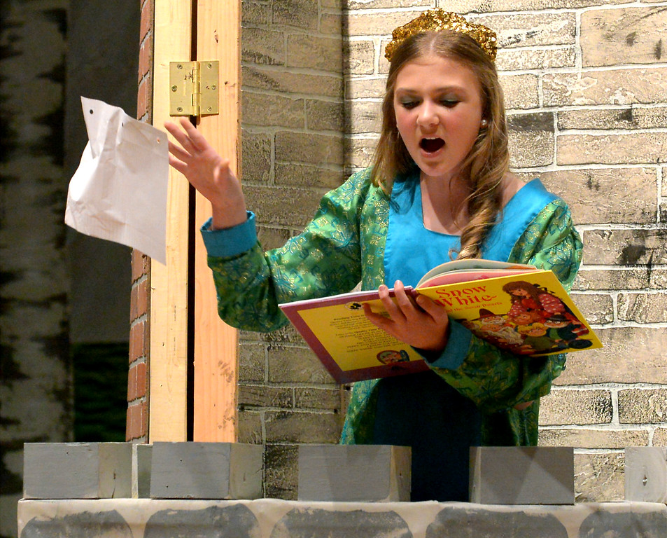 ". Bob Raines-- Digital First Media //  Princess Fiona (Callie Henrysen) rips pages from her fairy tale book, frustrated with having to wait so long to be rescued from the enchanted castle during the Apr. 11, 2016 rehearsal for the oung Starrs Theater Company production of ""Shrek, The Musical, Jr.\"""