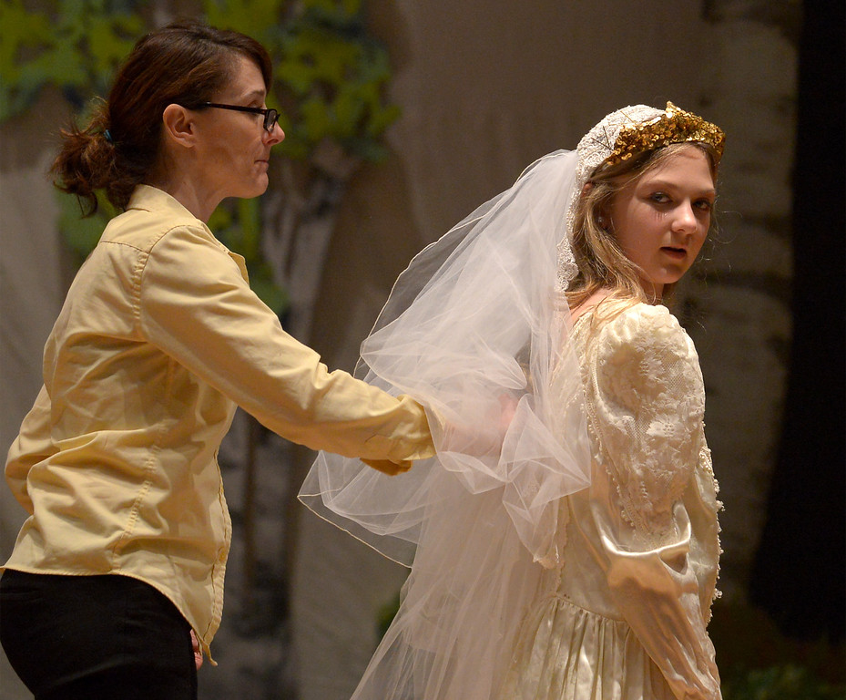 ". Bob Raines-- Digital First Media //  Volunteer Trisha Buchinski helps Callie Henrysen (Princess Fiona) with her wedding veil before the Apr. 11, 2016 rehearsal of Young Starrs Theater Company production, ""Shrek The Musical, Jr.\"""