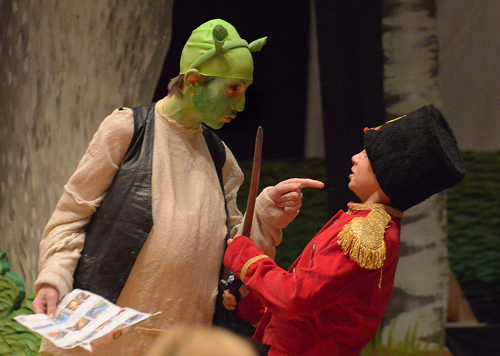 ". Bob Raines-- Digital First Media //  Shrek (Jason De Mets)  threatens Lord Farquaad\'s guards in the his Swamp during the Apr. 11, 2016 rehearsal for the Young Starrs Theater Company production of ""Shrek, The Musical, Jr.\"""