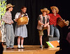 "Farmhands Hunk (Katie Brady-Gold), left, Zeke (Payton Breinich), center, and Hickory (Callie Henrysen), right, tell Dorothy (Adriana Novello) not to listen to old Miss Gulch during the July 10, 2016 rehearsal for YSTC's ""The Wizard of Oz."" _ Bob Raines 