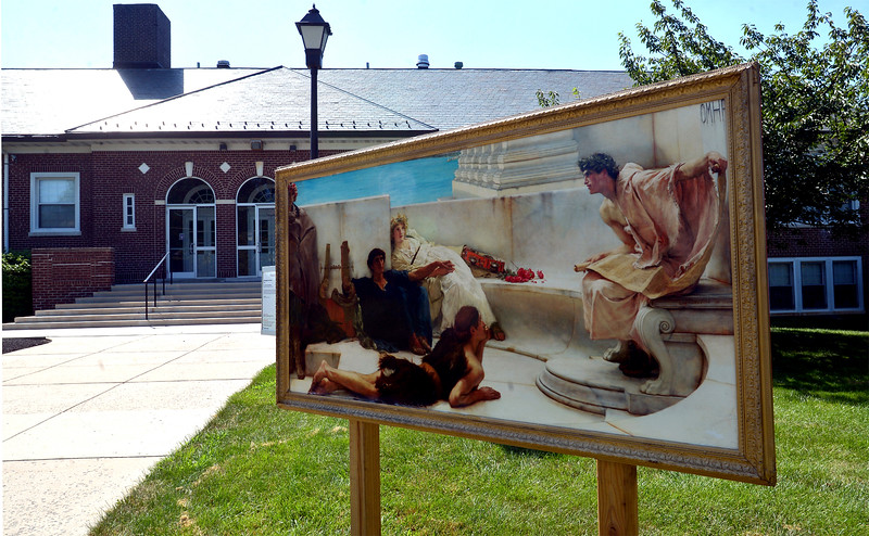 "Bob Raines--Digital First Media  |  <br /> ""A Reading from Homer,"" resides on the front lawn of Jenkintown High School  Aug. 13, 2016. This is one of 13 art works placed around Jenkintown as part of the Philadelphia Art Museum program, Inside Out."