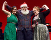 """Women wishing for extravagant gifts attempt to beguile the jolly elf in, """"Santa Baby,"""" during rehearsal Dec. 15, 2016. (Bob Raines--Digital First Media)"""