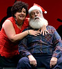 """Angela Bleemer bewitches the jolly elf (Al Feather) as she angles for Christmas bling in, """"Santa Baby,"""" during rehearsal Dec. 15, 2016. (Bob Raines--Digital First Media)"""