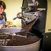 Jean Parry, president of Parry Coffee Roasters in Ambler, releases a batch of Guatemalan coffee beans into the cooling tray / PHOTO BY STACEY SALTER MOORE