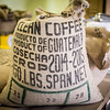 A sack of Guatemalan coffee beans sits on a pallet in the Parry Coffee Roasters plant in Ambler / PHOTO BY STACEY SALTER MOORE