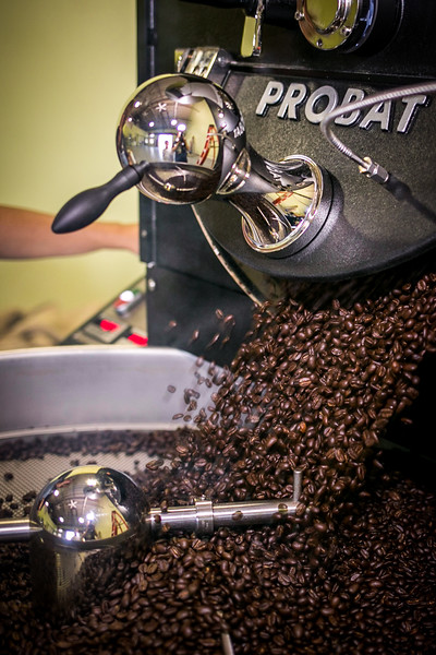 A batch of Guatemalan coffee beans spill into the cooling tray / PHOTO BY STACEY SALTER MOORE
