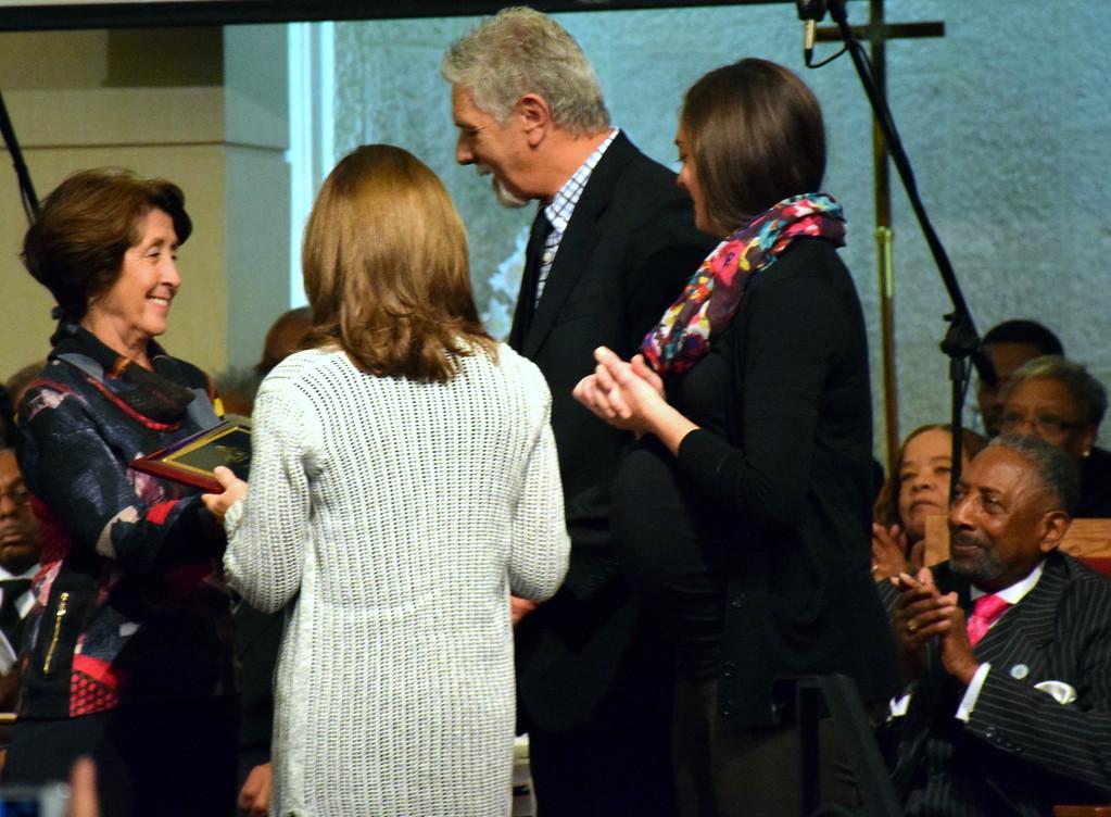 . Lei Barry presents the Interfaith Award to  Robert and Donna Kreamer and Kelly Kreamer-Curtis the Inter-Faith Award. Debby High - For Digital First Media