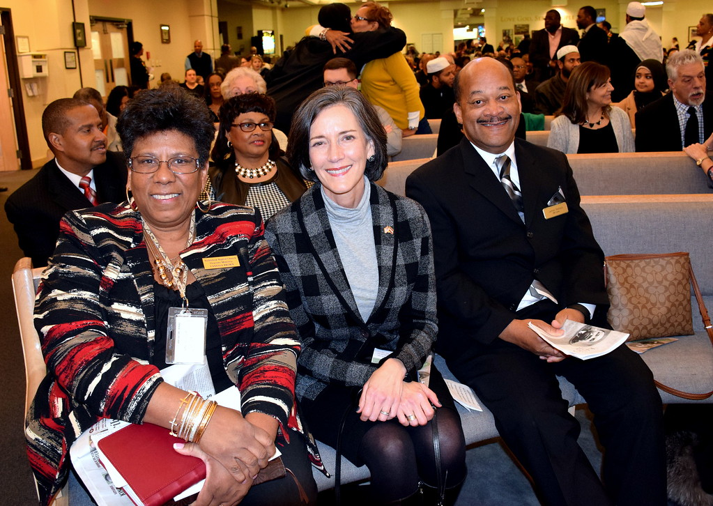 . Vanessa Brown, of Bethlehem Baptist Churc Deacons Ministry, left; Montgomery County Commissioner Dr. Valerie Arkoosh; and James Wallace attend the Wissahickon Faith Community\'s 21st annual communitywide service Jan. 15. Debby High - For Digital First Media