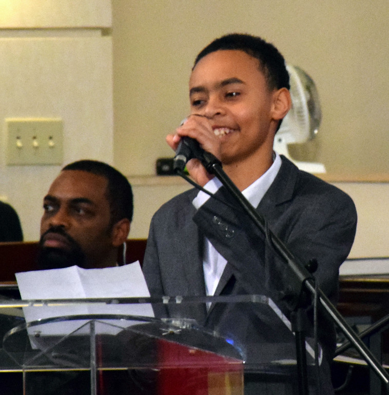 . Jaden Quann welcomes attendees to the Wissahickon Faith Community\'s 21st annual communitywide service Jan. 15. Debby High - For Digital First Media