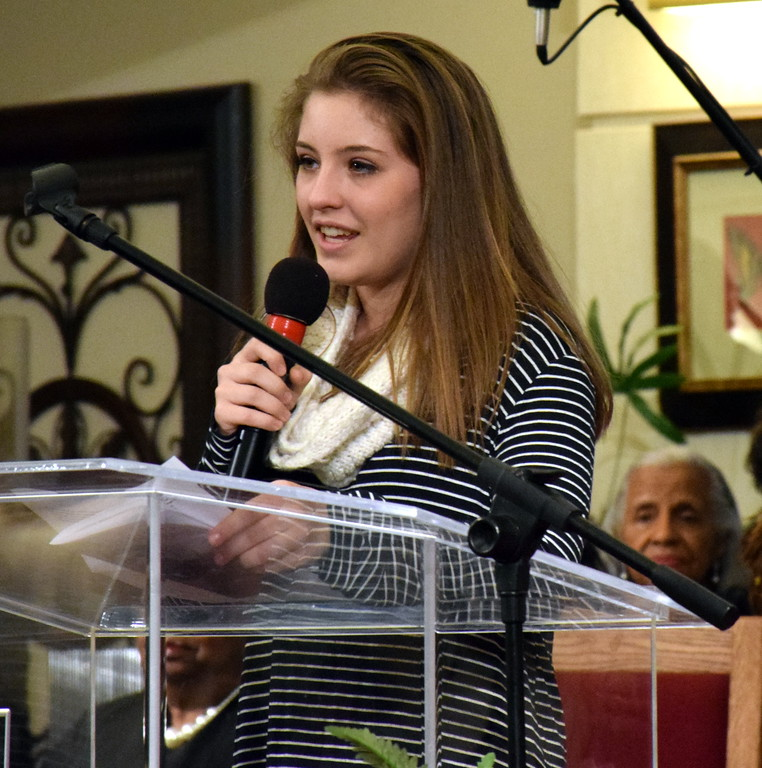 . Jenna Yorko introduces the  Rev. Dr. Alyn E. Waller, pastor of Enon Tabernacle Baptist Church. Debby High - For Digital First Media