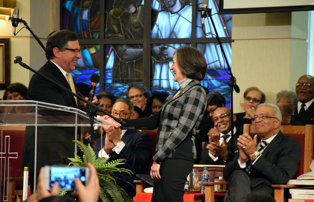 . Rabbi Gregory Marx presents the Justic and Peace Award for to Dr. Valerie Arkoosh. Debby High - For Digital First Media