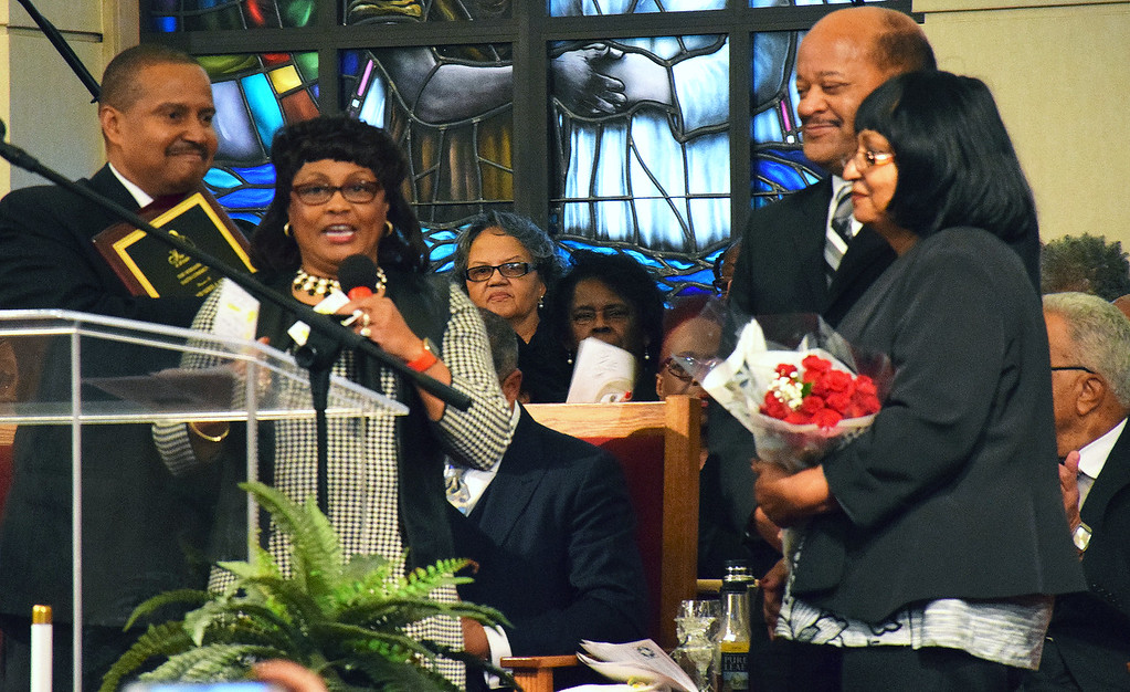 . Wayne and Tanya Holliday present the Kepper of the Dream Award to James and Sheila Wallace at the Wissahickon Faith Community\'s 21st annual communitywide service Jan. 15. Debby High - For Digital First Media
