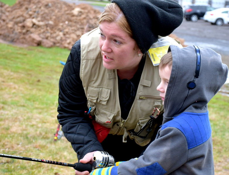 Amber Monte helps her son, Gabriel, to learn the techniques of fishing at the Pennridge Fishing Derby Saturday, April 9. Debby High — Digital First Media
