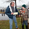 Jacob Westdyke, right, receives a gift for the most fish caught during the Pennridge Kids Fishing Derby from Ron Bolig. Debby High — Digital First Media