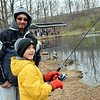 Kason Kessler takes part in the Pennridge Kids Fishing Derby with his dad, Roger, at his side. Debby High — Digital First Media