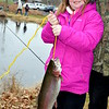 Krislyn Strohl, 9, of Sellersville, brings in a big catch at the annual Pennridge Kids Fishing Derby Saturday, April 9. Debby High — Digital First Media
