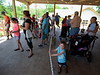 A crowd gathers under the waiting pavilion for their chance to feed a giraffe at the Welcome Home Party at the Elmwood Zoo, May 28, 2016.   / BOB RAINES--DIGITAL FIRST MEDIA
