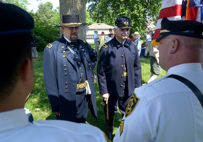 Randy Feranec (Major General Winfield Scott Hancock), left, and Mark Grim (Major General John Hartranft) thank the Sheriff's Department Color Guard for taking part in the Memorial Day ceremony at Montgomery Cemetery May 28, 2016. / BOB RAINES--DIGITAL FIRST MEDIA