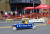 Spectators in front of the Montgomery Theater watch two racers cross the finish line during the Indian Valley Soap Box Derby on Main St., Souderton June 4, 2016. / BOB RAINES--DIGITAL FIRST MEDIA