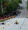 two cars pass the halfway point during the Indian Valley Soap Box Derby on Main St., Souderton June 4, 2016. / BOB RAINES--DIGITAL FIRST MEDIA