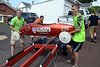 Scott Zeller and his son, Seth, lift their racer from the one of the custom trailers used to transport the cars back up to the pit area on Central Ave. during the Indian Valley Soap Box Derby June 4, 2016. / BOB RAINES--DIGITAL FIRST MEDIA