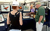 Bob Raines--Digital First Media<br /> Dawn Park and Tom Doerr look at artwork by Yvonne Torelli at the Ambler Art and Music Festival June 18, 2016.