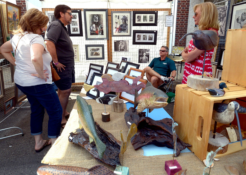 Joseph and Rochelle Evanosky, right, talk with shoppers at their Coal Region Art booth during the Ambler Art and Music Festival June 18, 2016. __ BOB RAINES-- DIGITAL FIRST MEDIA