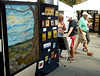 A couples stops to browse through a rack of art at Susan Hohman Fine Art at the Ambler Art and Music Festival June 18, 2016. __ BOB RAINES-- DIGITAL FIRST MEDIA
